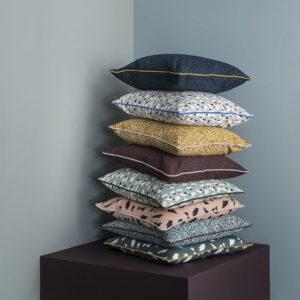 Ferm Living collezione cuscini decori floreali e geometrici.