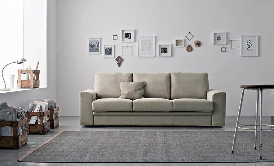 Decorare le pareti del soggiorno con foto e quadri: 10 idee.