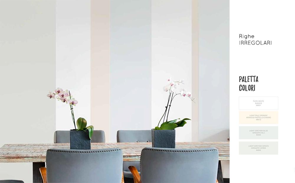 Dipingere casa a righe verticali irregolari.